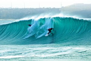Surfers carving up